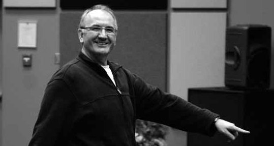 Memorial Photo of Keith Ewasiuk A Smiling Middle-Aged White Man Teaching Drama