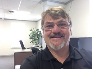 Smiling Middle Aged White Man with Glasses and Goatee