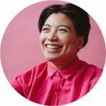 Filipinx Human With Septum Piercing And Pink Collared Shirt With Beaming Smile